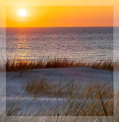 Zeezicht Verhuur Egmond ondergaande zon zee